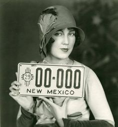 Actress Fay Wray presents the 1929 New Mexico license plate. Palace of the Governors Photo Archives HP.2012.20.2.