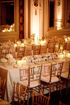 Love the glow of white, blush, and gold with the candle lighting.