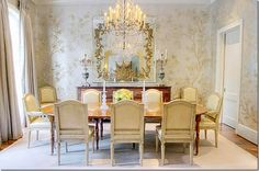 The Houston dining room is so beautiful with handpainted wallpaper and a gorgeous chandelier.