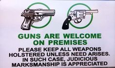 Sign posted outside Shooters Grill, located in the gun-friendly town of Rifle, Colorado.