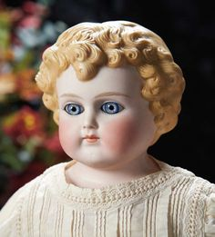 German Bisque Doll with Sculpted hair and Glass Eyes, Model 890, Alt, Beck and Gottschalk --Marks: 890 #9. Comments: Alt, Beck and Gottschalk, circa 1880. Value Points: rarity factors include maker's mark, glass eyes, well-detailed sculpting of curls.
