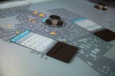 Stadtplanung  Die Bachlorarbeit »Stadtplanung« ist ein Konzept für ein Tangible Tabletop Interface, welches bei Diskussionsrunden im Stadtplanungsprozess zum Einsatz kommen soll.
