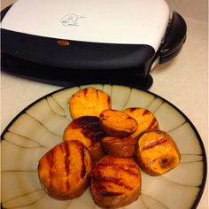 George Foreman grilled sweet potato. Cut into slices of desired thickness. Drizzle olive oil ( or coconut oil) dash of salt and dash of brown sugar. Grill until slices are tender :)