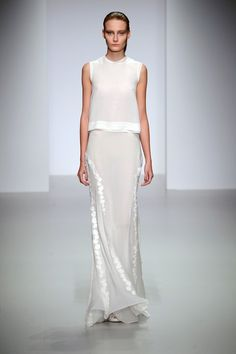 Plain, white, yet pretty and elegant with a bit of sparkle.    Love the fluidity of the skirt.