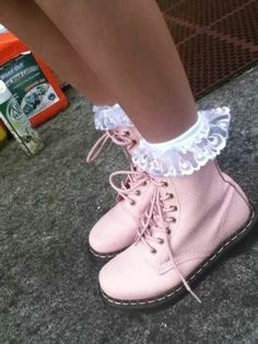 Cute lace socks sticking up over Doc Martins. Very kawaii <3