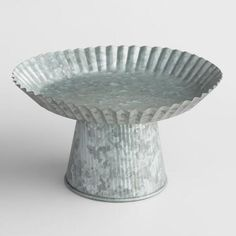 Available in three sizes, our exclusive, handcrafted cake stand is an attractive centerpiece alone, stacked or grouped in multiples. Featuring an Zinc finish and scalloped edges, it makes a standout presentation of wrapped snacks and treats.