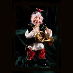 """Kurt Adler 16 9/10"""" Jacqueline Kent Jimmy S. Santa Decoration. Santa is ready to play festive music in this cheery decoration. Dressed in his holiday best and sporting a merry smile, this figure holds a French horn to commemorate the musical magic of the season. This jolly Santa is a unique and fun way to showcase holiday spirit in almost any home. Product Features: Jolly Santa poses with a French horn Dressed in festive holiday colors Lovely addition to virtually any holiday collection…"""