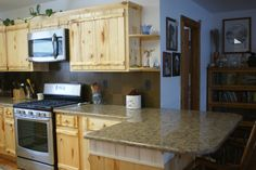 """Michelle chose the 3"""" x 6"""" Peel And Stick Aspect Tiles to finish her kitchen backsplash.  She says, """"We chose the brushed bronze.  We started putting them up last night.  They look wonderful with our new quartz counter tops and Aspen cabinets!"""""""