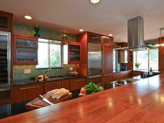 Kitchen inspiration (colorful green glass backsplash, cherry cabinets, and dark granite counters)