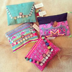 Gorgeous candy-coloured embroidered coin clutches by Love Birds LA.