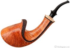 This is an amazing pipe, but is ridiculously expensive.    Kent Rasmussen Partially Rusticated Horn with Mazur Birch Pipes at Smoking Pipes .com