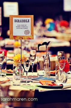 Board games as centerpieces--love this idea!  These would make a reception fun!  Plus, I just really LOVE games! wedding place cards, sports wedding place cards #wedding #weddings