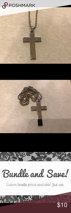 "Steel solid cross pendant necklace Beautiful, solid steel cross pendant comes on silver plated bead ball necklace (22"").  Cross measures approximately 2"" tall.  Great for men and women.  Makes a great gift! Free surprise jewelry gift with your purchase! Jewelry Necklaces"