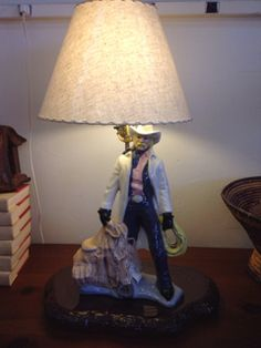 VINTAGE CERAMIC COWBOY LAMP WITH SHADE, SIGNED CHRIS C. ON THE BOTTOM, IN GOOD WOKING CONDITION. 24H X 14W X 9D
