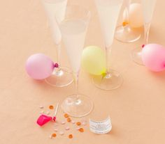 Grab your guests attention with the signature cocktail. This festive idea involves balloons and confetti. Need we say more?