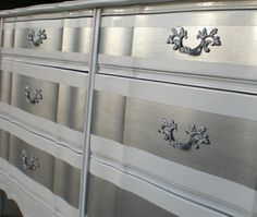 this is just like my childhood dresser.  Still have it, but haven't a clue where I'd put it.  The silver would really freshen it up!