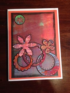 Upright three rings and flowers. Handmade card using Gelli plate and mixed media.
