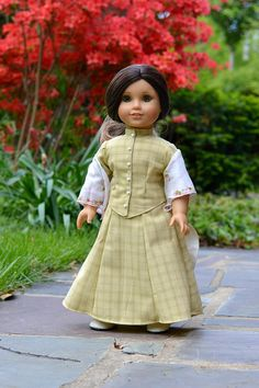 This is a beautiful, classic outfit made up of the two piece jacket and skirt, and a vintage hankie shawl. The jacket is made in a soft pale green homespun cotton lined in ivory, with cuffs at the sleeves and little porcelain buttons up the front. Closes in front with hooks and eyes. The skirt is made in the same fabric and features a beautiful cascading bustle in the back. Lastly, the gorgeous shawl is made of a vintage hankie, with little rosebuds scattered all over.  Includes: jacket…