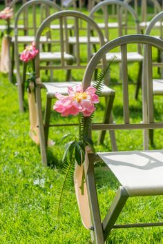 A single flower lines the aisle chairs: http://www.stylemepretty.com/2014/12/01/floral-covered-wedding-in-rockport-maine/ | Photography: Justin & Mary - http://justinmarantz.com/
