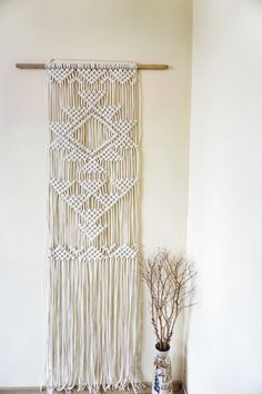 Contemporary macrame wall hanging for decorating your home, garden, yoga studio, wedding or any other special event. The design is unique and its inspired by ancient symbols for eternal life. Variations in size are available. Ready to ship!  MATERIALS Cotton rope WEIGHT 0.96kg (2.11 lbs) COLOURS The macrame piece is ecru.  SIZES Without the stick: 45x167cm (17.7x65.7 inches) The stick itself is 75cm (29.5 inches)  You can also choose your own custom size if the one stated is not exactly…