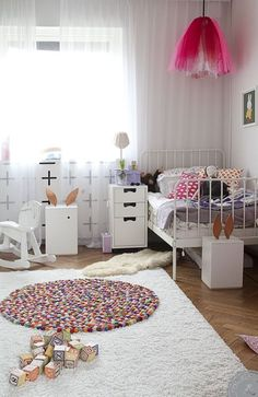 Cute little kids room with layered rugs