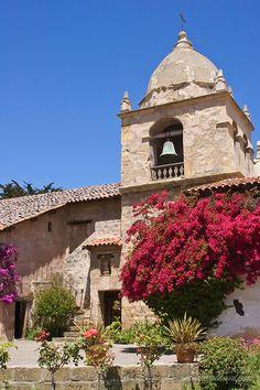 Courtyard, Bougainvillea and bell tower at San Carlos Borromeo del Rio Carmelo Mission; Carmel, California.