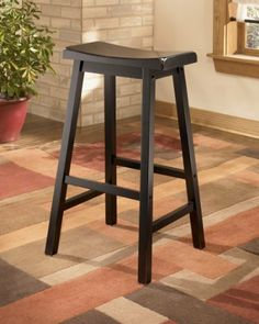 """Conrad Tall Bar Stools (set of 2) by Famous Brand Furniture. $93.36. Rubbed black finish. Made with veneers and hardwood solids. 17.38"""" W x 14"""" D x 29.5"""" H. Perfect for small spaces. Includes 2 stools. With the rich dark finish and straight-lines contemporary design, the """"Conrad"""" bar stools offers a sophisticated look that is sure to perfectly accent the style of any dining room decor. The rich beauty of the rubbed black finish flows smoothly over the subtle tapered legs and shar..."""
