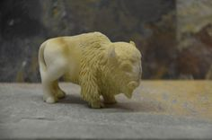 Bison hand carved from bone. Very detailed and a great collector item.