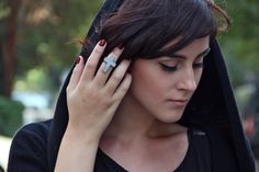 Cross ring worn on blogger