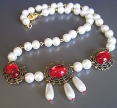 """Princess Isolde Necklace & Earring Set - A beautiful set, comprising a 22"""" necklace of glowing ruby-red glass jewels and whitest glass pearls, and matching earrings whose pearls dangle and dance 3/4"""" below surgical steel French hook ear wires. An eye-catching addition to your jewelry wardrobe. $45"""