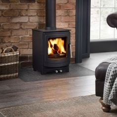AGA Ellesmere Stove from AGA Stoves - Visit AGA Wales showrooms for more information on the Ellesmere Multi-fuel Stove Traditional Interior, Traditional Design, Electric Smoke, Aga Stove, Wood Fuel, Multi Fuel Stove, Iron Doors, Wood Burning, Home Appliances