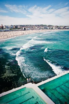 Bondi Beach, Australia summer blue sky beach ocean water clouds people
