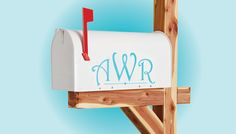 Personalize a mailbox by adding elegant painted initials using only shelf liner and paint.