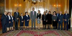 Don Felipe and Princess Letizia pose with representatives Oviedo Economic Kitchen and Daughters of Charity of St. Vincent de Paul in the Hall of Councils of the Reconquista Hotel in Oviedo