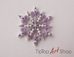 This little snowflake ornament is just like a jewel for your Christmas tree! You can use it for winter decoration, wedding favor, gift topper, etc. The snowflake could be the perfect present. It is gift packaged. The snowflake is made in quilling technique, also knows as paper