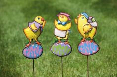 "Easter Chicks Garden Stakes - 3 assorted by Accent Your Life. $38.24. Hand painted; Made of metal; Set of 3 garden stakes; Approximate dimensions are 6"" x 35.5"". Easter is a holiday that sets up the tone for spring, renewal and hope. This set of three metal garden stakes is hand painted with vibrant and cheerful colors, making it a welcoming outdoor accent for the spring season."