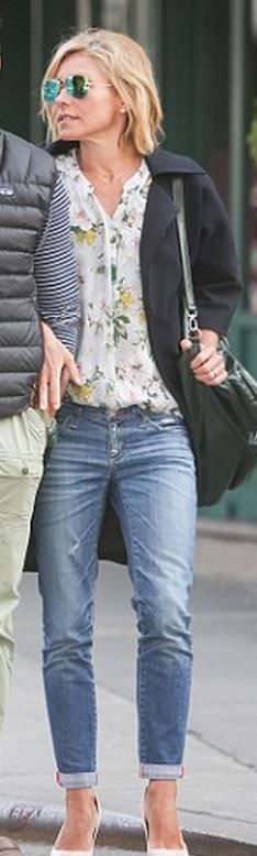 Who made Kelly Ripa's white floral top, green leather back pack,  and blue jeans