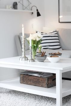 White and grey living room. Love the colour scheme and love the stripy cushion which breaks it up