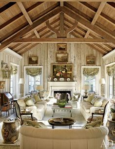 In Nancy and Bill Morton's Florida home, the living room's pecky-cypress paneling was lightened by decorative painter Bob Christian, whose work can also be seen on the tile fireplace surround. The landscape paintings are English, the roll-arm Architectural Digest, Architectural Sketches, Florida Villas, Florida Home, Florida Living, Fireplace Tile Surround, Fireplace Surrounds, Pecky Cypress Paneling, Barn Living
