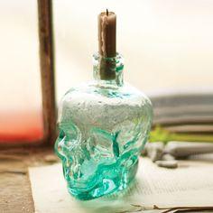 "Santa Muerte Bud Vase | dotandbo.com $34.99 QUALITIES  Dimensions: 4"" W x 5"" D x 6.5"" H  Material: Glass"