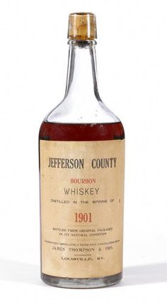 """Jefferson County Bourbon Whiskey 1901 James Thompson & Bro. """"Distilled in the Spring of 1901. Bottled from Original Packages in its Natural Condition. Guaranteed Absolutely Pure and Unadulturated by James Thompson & Bro., incorporated, Louisville, KY."""" Tiny nick in label. All writing intact and sharp. 'Capacity One Full Quart'"""