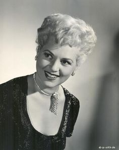 Judy Holliday.   She had an extremely, extremely high I.Q.  Amazing actress often playing the 'dumb blonde'.