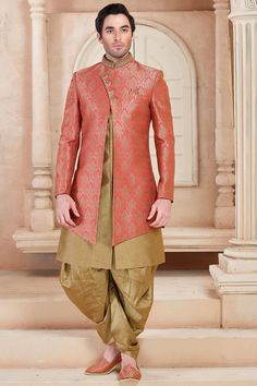 Marvelous Peach and golden color brocade silk indo western with contrast buttons and collar is pleasing appearance. Comes with golden color patiala. Get the opportunity to be the best with this outfit. Indian Groom Dress, Wedding Dresses Men Indian, Wedding Dress Men, Indian Wear, Wedding Suits, Wedding Vows, Wedding Wear, Mens Sherwani, Sherwani Groom
