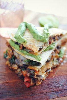 {Tempeh and black bean quesadillas with avocado cilantro lime crema.}