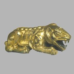 Scythian Lion Statuette, 9th-8th Centuries B.C.  Bronze: molding, gilding The Museum of Russian
