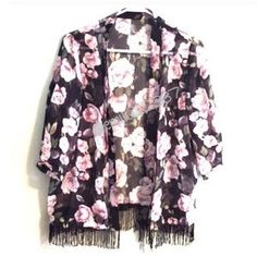 I just discovered this while shopping on Poshmark: Rose Print Fringe Kimono. Check it out! Price: $15 Size: M