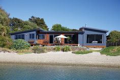Fowler Homes water front gold | NZ Metal Roofing Manufacturers