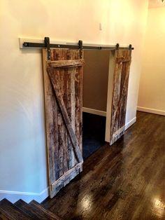Reclaimed barn wood doors by Meridian Construction and David Weis.  #LouisvilleHomeBuilder #HomeBuildersLouisville #LouisvilleNewHomes #LouisvilleBuilders #Custom #HomeBuilderLouisville #LouisvilleCustomHomeBuilder #CustomHomeBuilder #CustomBuiltHomesLouisville #MeridianConstruction #NortonCommons #Homearama