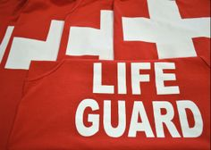 custom red Life Guard tank top by Big Star Branding: we have been locally owned and operated in San Antonio for over 27 years providfing the best quality custom screen printing, custom embroidery, custom imprintable promtotional products and anything else you can think to print on to help promote, advertise or market your business, event, school, organization or team uniforms: visit us online at bigstarbranding.com