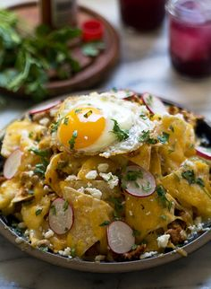 Everything's better with an egg on top — even nachos.